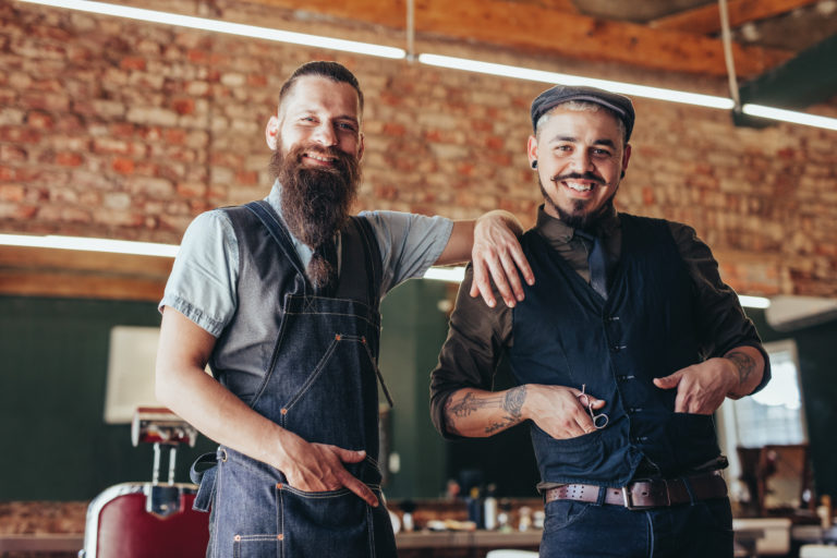 Portrait,Of,Professional,Hairdresser,With,His,Client,Standing,In,Barber