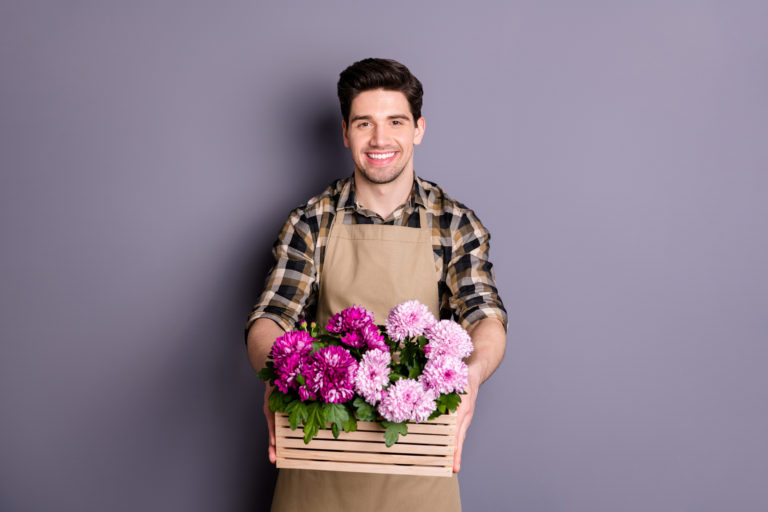 Photo,Of,Cheerful,Positive,Man,Smiling,Toothily,Working,As,Florist